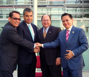 State Senator Gilbert Cedillo (left) (D-Los Angeles) joins hands with Assemblyman Mike Eng (R), Mayor Steve Placido of Alhambra and Mayor David Sifuentes of South Pasadena at news conference downtown to urge the Governor to sign SB 545. (photos by George Mc Quade)