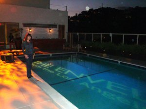 President Aida Mayo, MAYO Communications stands by theenvelope.com lit up pool on the top floor of the W. Hollywood hotel.(image by MAYO Comm.)
