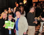 Image of people holding O'Dwyer PR Directories at EPPS Mixer