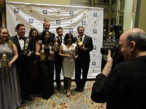 The TV and Radio Golden Mike Winners pose on the carpet with their awards for the best in Broadcast News.
